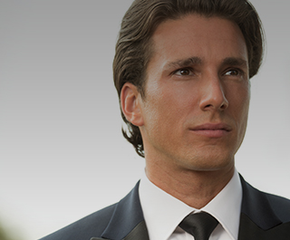 A man who received BOTOX® Cosmetic is dressed in a suit and looks focused