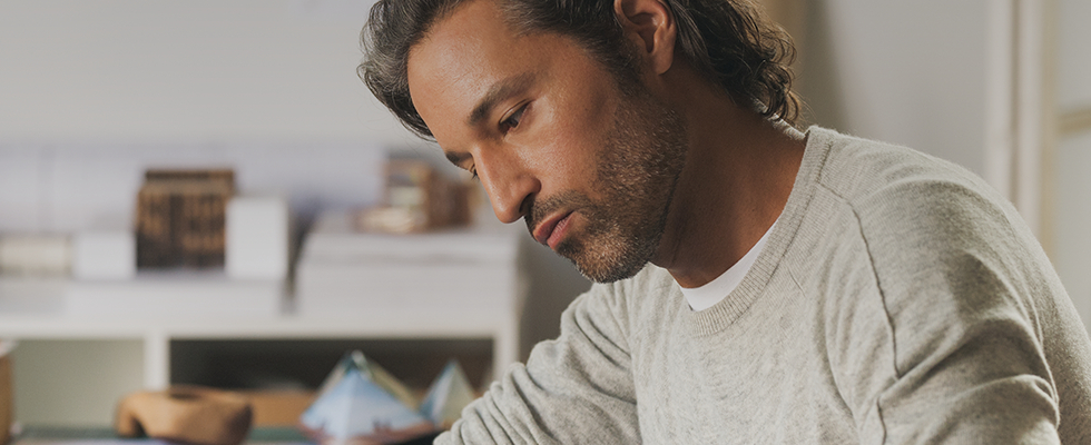 A man who received BOTOX® Cosmetic looks focused