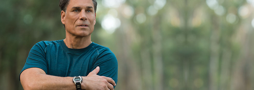 A man who received BOTOX® Cosmetic pauses during a run outside